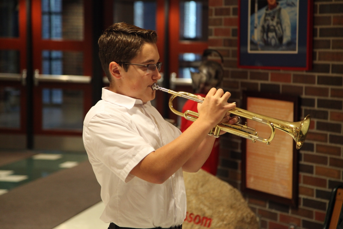"Grissom student plays ""Taps"""