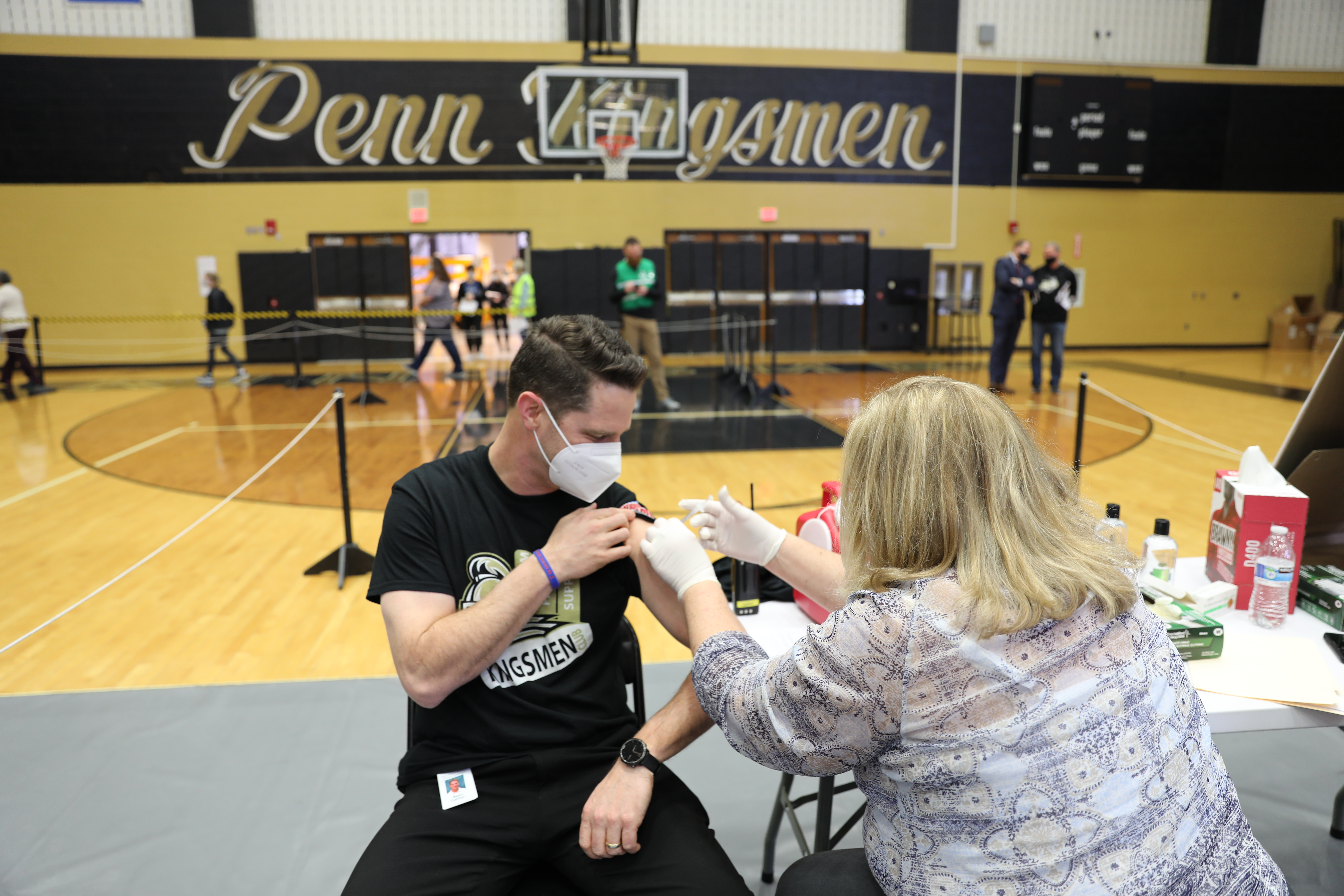 Meijer Clinical Pharmacy Specialist Amy Jennings administering vaccine to Penn Principal Sean Galiher